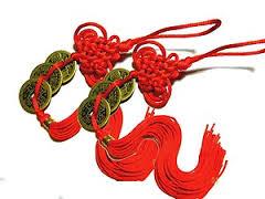 Tre Kinesiska lyckomynt